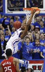 Kansas' Robinson yells after his successful dunk against Nebraska in Lawrence, Kansas
