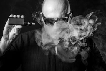Smoking e-cigarette.