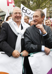 French Socialist Mayor of Paris Delanoe and Huchon, president of the Ile-de-France region attend the annual May Day march in Paris