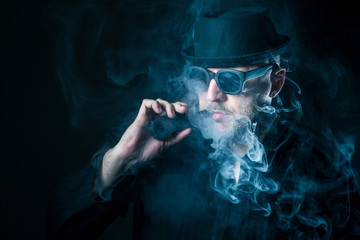 Vape. E-cigarettes. The smoke exhales. Smoking of electronic cigarettes. Vapor,