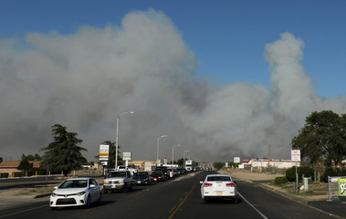 Cars get away from the North Fire near Phelan