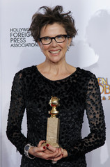 Bening poses with award for Best Performance by an Actress in a Motion Picture - Comedy Or Musical at the 68th annual Golden Globe Awards in Beverly Hills