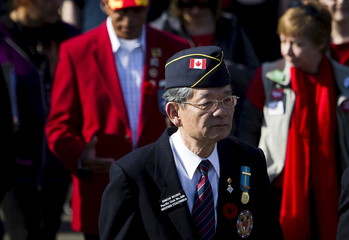 Retired veteran Simon Wong walks during Canada's inaugural Charter of Rights and Freedoms march in Vancouver.