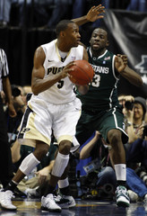 Pudue's Johnson turns on Michigan State's Green during a mens Big Ten tournament game in Indianapolis