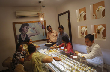Customers shop inside a gold jewellery showroom in Mumbai