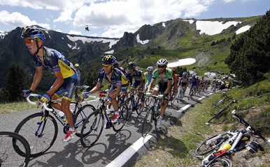 Gallopin of France leads ahead Contador of Spain as they climb the Pailheres pass in the Pyrenees during the 195 km eight stage of the centenary Tour de France cycling race from Castres to Ax 3 Domaines