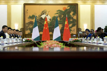 Nigerian President Jonathan introduces ministers in his cabinet as Chinese President Xi watches, during their meeting in Beijing