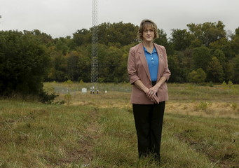 Former Loudoun County Commissioner Kelly Burk is pictured near one of three towers that broadcast Beijing radio in Ashburn, Virginia