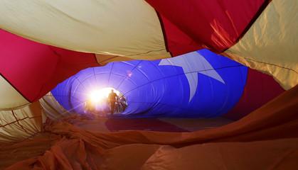 People prepare a hot air balloon with an Estelada design (Catalan separatist flag), during the European Ballon Festival in Igualada