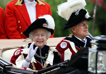 Britain's Queen Elizabeth and the Duke of Edinburgh leave after the procession of the Order of the Garter in Windsor