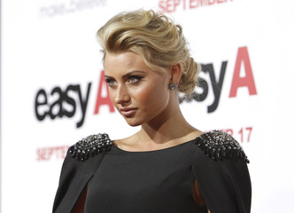 "Michalka poses at the premiere of ""Easy A"" at the Grauman's Chinese theatre in Hollywood"