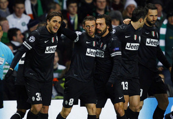 Juventus' Alessandro Matri celebrates with teammates after they scored their first goal against Celtic during their Champions League soccer match at Celtic Park stadium in Glasgow