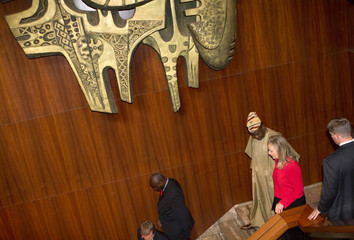 Nigeria's Foreign Minister Ashiru walks U.S. Secretary of State Clinton out of the Presidential Villa in Abuja