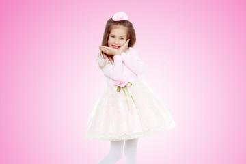 Elegant little girl in a pink dress.