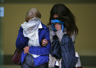 Ann and Daniela Skinner, the wife and daughter of Domenico Rancadore, leave Westminster Magistrates' Court in London