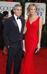 Actor and director George Clooney and Stacy Keibler pose as they arrive at the 69th annual Golden Globe Awards in Beverly Hills