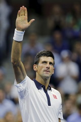 Djokovic celebrates victory over Agut in their fourth round match at the U.S. Open Championships tennis tournament in New York