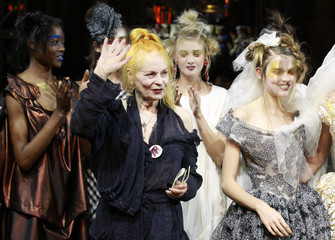 Westwood joins her models on the catwalk at the end of her Spring/Summer 2012 women's ready-to-wear fashion collection show in Paris