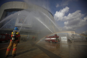 Firefighters take part in an anti-terror and security drill at a department store near Gimpo airport in Seoul