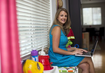 Chief executive of California-based social and educational group for parents Club MomMe Rachel Pitzel poses for a picture at her home in Playa Vista, California