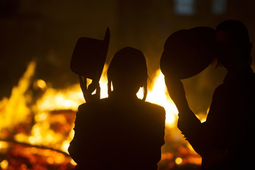 Ultra Orthodox Jewish men watch a bonfire during the Jewish holiday of Lag Ba-Omer in Jerusalem