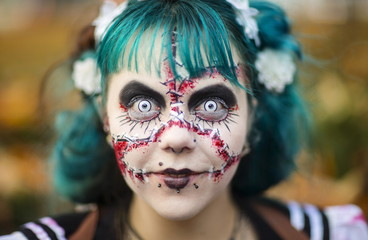 Woman takes part in a zombie walk during Halloween celebrations in Berlin