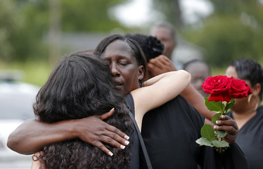 Veda Sterling, aunt of Alton Sterling, hugs a well-wisher as family members and friends attend the burial of Alton Sterling at the Mount Pilgrim Benevolent Society Cemetery in Baton Rouge
