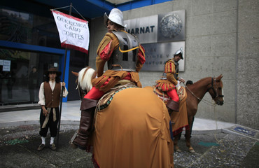 Greenpeace activists dressed as Spanish conquerors protest against Spanish real estate developer Hansa Urbana in Mexico City