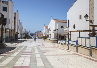 Wide pedestrian avenue in residential area of Puerto de las Nieves on Gran Canaria, one of the Canary Islands.