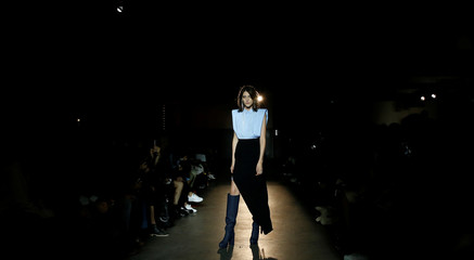 A model presents a creation by German designer Lutz Huelle as part of his Spring/Summer 2017 women's ready-to-wear collection during Fashion Week in Paris