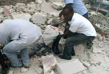 Video grab of an injured person being pulled from a structure that collapsed after an earthquake in Port-au-Prince