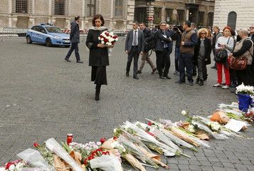Italian Lower House President Laura Boldrini arrives to lay flowers, in sympathy with the victims of the Paris attacks, in front of the French embassy in Rome