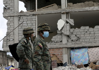 Soldiers stand guard outside a collapsed building in Pedernales, after an earthquake struck off Ecuador's Pacific coast