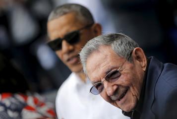 U.S. President Barack Obama and Cuban President Raul Castro arrive to attend a baseball game at Estadio Latinoamericano in Havana