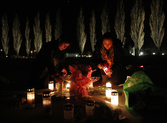 People pay tribute to the victims of a bus crash in Sierre