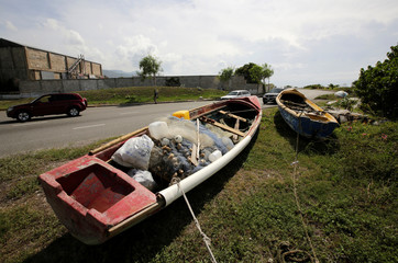 Boats are secured off a beach as Hurricane Matthew approaches in Kingston