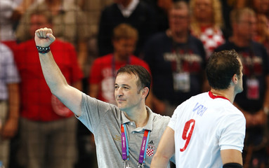 Croatia's coach Slavko Goluza gestures beside his player Igor Vori after they beat Hungary in their men's bronze medal handball match during the London 2012 Olympic Games