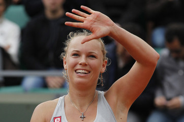 Wozniacki of Denmark celebrates after winning her match against Pennetta of Italy during the French Open tennis tournament at Roland Garros in Paris