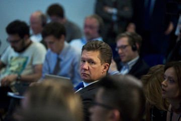 Gazprom Chief Executive Miller listens to Ukrainian Energy Minister Yuri Prodan (not pictured) speak during news conference after EU-Ukraine-Russia energy negotiations at EU commission representation in Berlin