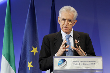 Italian Prime Minister Mario Monti delivers a speech during the 4th annual New World conference in Paris