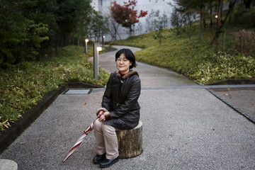 Translator Kaori Oguni poses for a picture after an interview in Tokyo