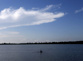 A fisherman throws his net to catch fish in a lagoon in Batticaloa
