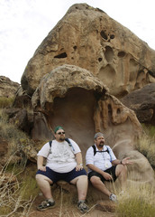 "Guests at the Biggest Loser Resort in Ivins, Utah Jerry Murray and Everett Blair rest in the ""Hippos Mouth"" rock formation on one of their daily hikes"