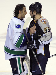 Vancouver Canucks goalie Roberto Luongo shakes hands with Nashville Predators defenseman Shane O'Brien after winning Game 6 of the NHL Western Conference semi-final hockey playoff in Nashville