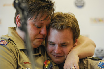 Jennifer Tyrrell hugs Pascal Tessier after a resolution passed to allow openly gay scouts in the Boy Scouts in Grapevine