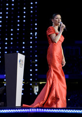 """Welsh actress Catherine Zeta-Jones speaks on stage during """"Welcome to Wales"""", the Ryder Cup celebration concert at the Millennium Stadium in Cardiff"""