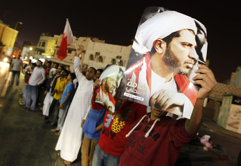 Protesters shout anti-government slogans as they gather outside Salman's home, in the village of Bilad Al Qadeem
