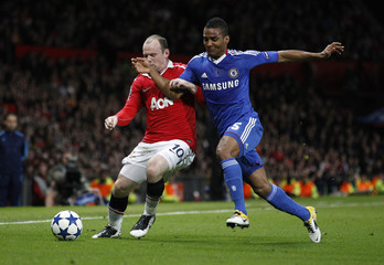 Manchester United's Rooney challenges Chelsea's Malouda during their Champions League quarter-final second leg soccer match