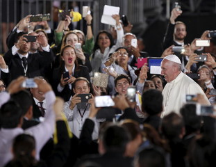 Pope Francis is being greeted by people as he arrives at the airport in Ciudad Juarez