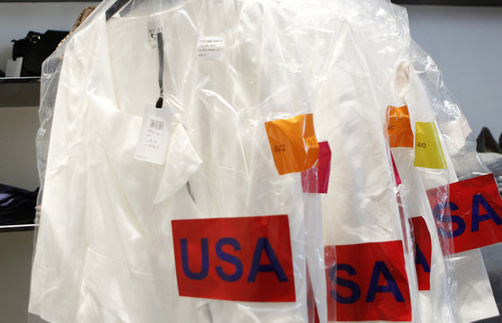 """Shipping labels are seen on the packaging for a rack of """"Nannette"""" model dresses made famous by British royal bride-to-be Kate Middleton at a Reiss store in New York"""